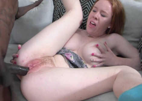 Busty redhead Kierra takes some black dick